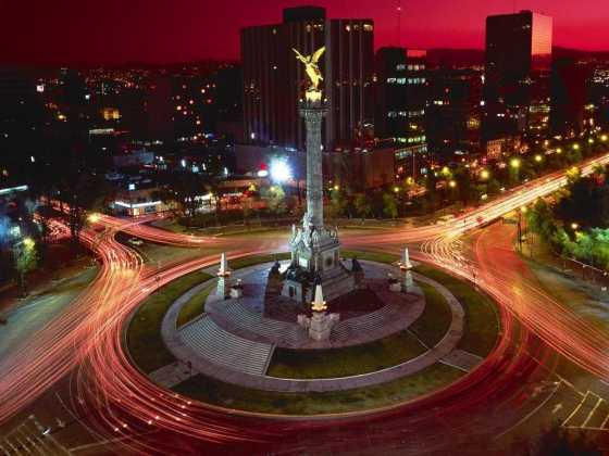 Night time traffic around El Angel de la Independencia, Mexico City.